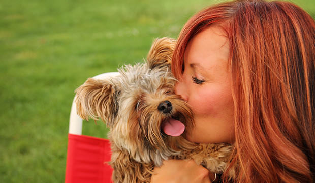 bigstock-a-woman-with-her-beautiful-dog-75255730