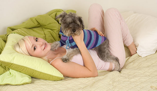 bigstock-Young-Woman-In-Bed-Playing-Wit-24935243