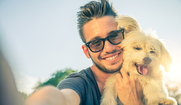 bigstock-young-man-and-his-dog-taking-a-73517944